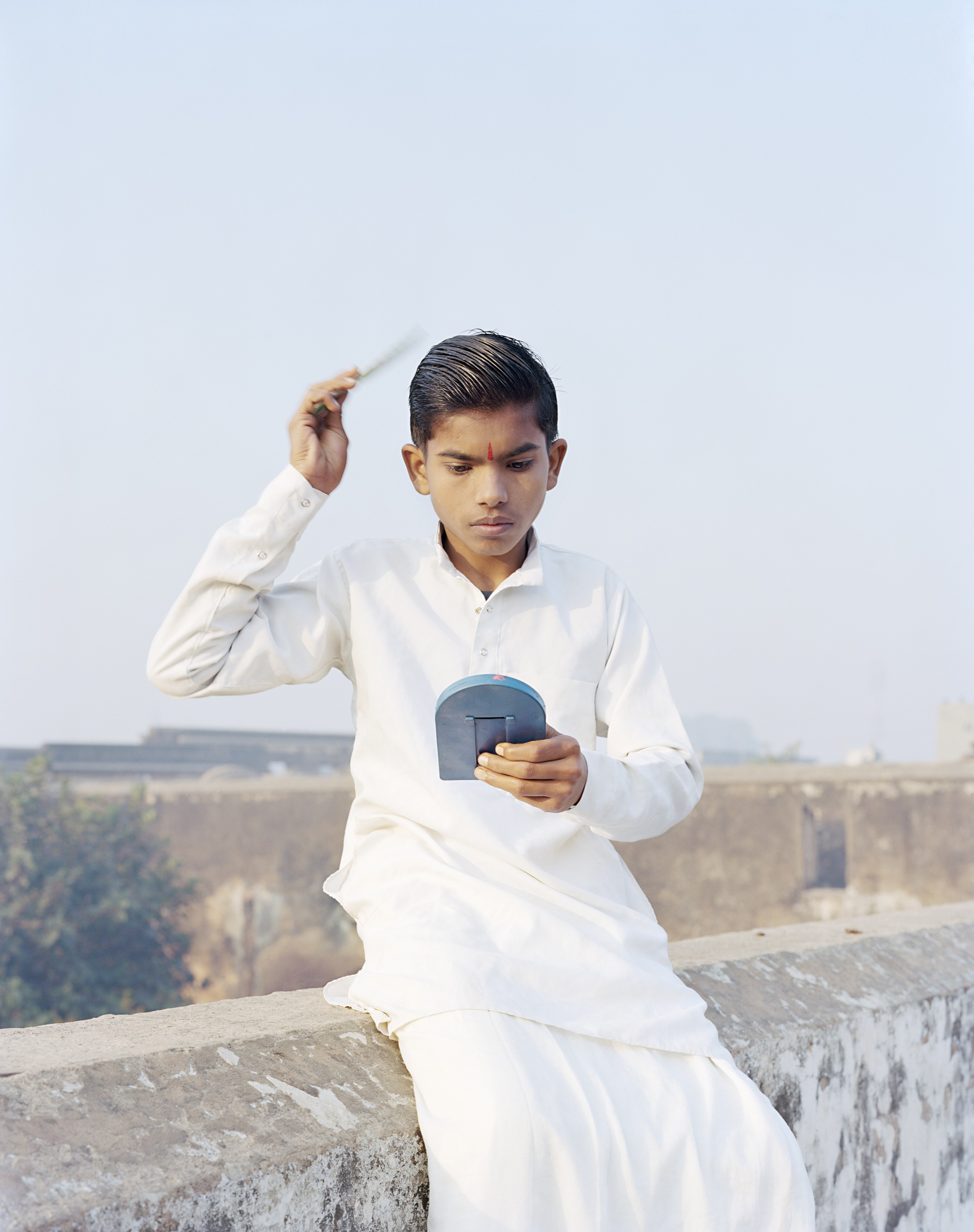 Rama Combing His Hair Ayodhya, India, 2015 ©Vasantha Yogananthan